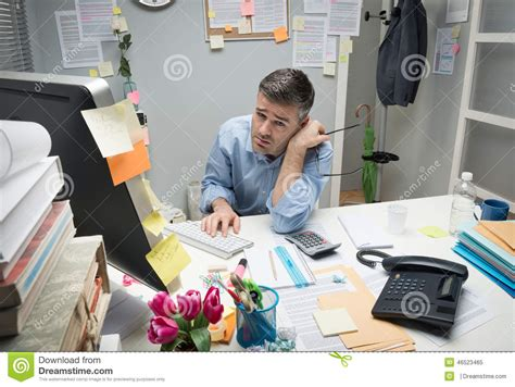 Depressed Office Worker At His Desk Stock Image - Image of